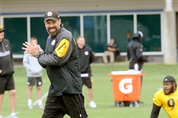 Steelers offensive coordinator Todd Haley flashes a smile June 8 during workouts on the South Side.