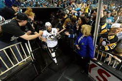Sidney Crosby heads to the ice surrounded by Penguins and Sharks fans before Game 4 in San Jose Monday night.