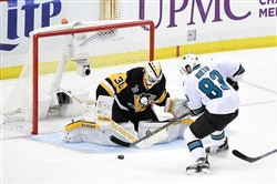 Matt Murray fends off San Jose's Matt Nieto in the second period Thursday night. Murray allowed three goals in the first period before settling down.