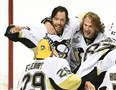 The Penguins' Matt Cullen celebrates with Carl Hagelin after beating the San Jose Sharks in Game 6 to win the Stanley Cup at the SAP Arena in California.