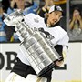 Penguins goaltender Marc-Andre Fleury carries the Stanley Cup after defeating the Sharks Game 6 of the Stanley Cup final at SAP Center in San Jose, Calif.