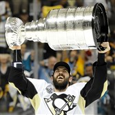 The Penguins' Justin Schultz hoists the Stanley Cup after Game 6 of the Stanley Cup final in San Jose.