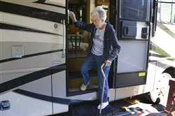 Norma Bauerschmidt, 91, climbs out of the family's RV at the Bear Run Campgrounds near Portersville.