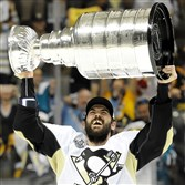 Justin Schultz hoists the Stanley Cup after the Penguins defeated the Sharks in the NHL championship. On Monday, the Penguins allowed Schultz to become an unrestricted free agent.