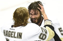Carl Hagelin and Kris Letang celebrate after the Penguins beat the Sharks to win their fourth Stanley Cup Sunday at SAP Center in San Jose, Calif.