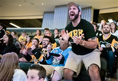 Matt Hauser cheers during Game 6 of the Stanley Cup final Sunday. The Penguins had a watch party at Consol Energy Center.