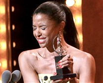 "Renee Elise Goldsberry accepts the award for featured actress in a musical for ""Hamilton."""