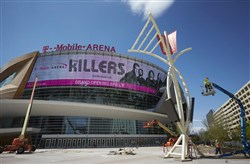 In this March 28 photo, workers finish construction on the 20,000-seat multipurpose T-Mobile Arena in Las Vegas.