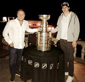 Evgeni Malkin, right, and his friend Alexey Ubeyvolk pose with the Stanley Cup Monday night in Sewickley.