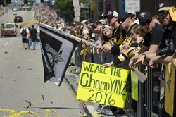 Fans line up along the Boulevard of the Allies for the Penguins' Stanley Cup celebration parade June 15.