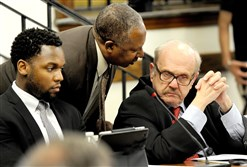 Thomas Sumpter, center, speaks Wednesday with attorney Ira Weiss, right, as Ronald Joseph listens to the agenda at a Pittsburgh school board meeting in Oakland.