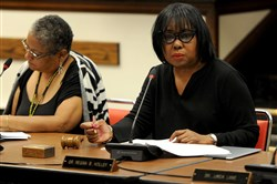 Regina B. Holley listens to the agenda during a Pittsburgh school board meeting in Oakland in June.
