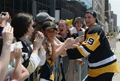 Beau Bennett greets the crowds as the Penguins hold a Stanley Cup championship parade Downtown Pittsburgh. Penguins traded Beau Bennett  to New Jersey for a third-round choice.