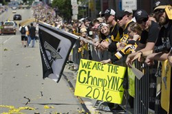 Fans show off their Penguins gear before the victory parade along the Boulevard of the Allies Wednesday.