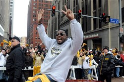 Steelers head coach Mike Tomlin celebrates during the Steelers' Super Bowl parade in 2009.
