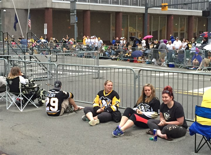 penguins parade 062016 Penguins fans stake out spots behind barricades along Stanwix Street at the Boulevard of the Allies this morning
