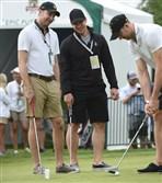 Putting practice for Penguins' Jeff Zatkoff, Sidney Crosby and Eric Fehr during U.S. Open in Oakmont today.