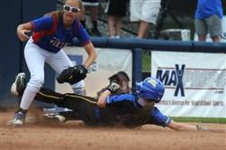 Williams Valley's Kenna Ferron tags out a West Greene runner at third base in the PIAA Class A softball championship Thursday morning at Penn State. West Greene lost, 3-2.