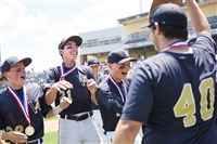 Vincentian players celebrate their state title Friday.