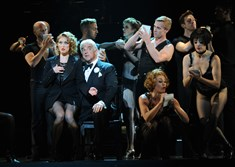"Dylis Croman as Roxie Hart and John O'Hurley as Billy Flynn with the cast of Pittsburgh CLO's ""Chicago"" in the number ""We Both Reached for the Gun."" ""Chicago"" is at the Benedum Center through June 26."