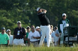 Shane Lowry of Ireland plays his shot from the 18th tee  during a continuation of the third round of the U.S. Open at Oakmont Country Club on Sunday morning.