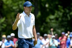 Jordan Spieth acknowledges fans on the 16th green Saturday during the continuation of the second round of the U.S. Open at Oakmont Country Club.