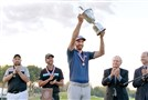 Dustin Johnson hoists the trophy as Jack Nicklaus looks on Sunday at the U.S. Open at Oakmont Country Club.