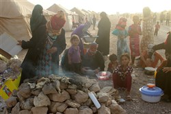 Displaced Iraqis from the embattled city of Fallujah are seen at a camp Monday in Amiriyiah al-Fallujah.