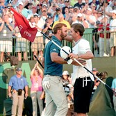Dustin Johnson hugs his caddie after winning the U.S. Open Sunday at Oakmont Country Club.