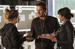 "Imogen Poots as Kelly Ann, left, Luke Wilson as Bill and Carla Gugino as Shelli are behind the scenes on a tour with a band in Showtime's ""Roadies."""