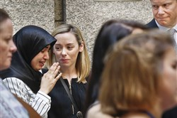 Muna Abbas, 24, left, who grew up with slain British lawmaker Jo Cox and worked with her in Parliament, cries Wednesday in New York after speaking at her memorial. A crowd of about 100 gathered near the U.N. on what would have been Ms. Cox's 42nd birthday.