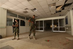 Iraqi soldiers inspect the hospital in Fallujah, Iraq, on Wednesday.