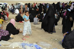 Internally displaced civilians from Fallujah, who fled their homes during fighting between Iraqi security forces and the Islamic State group, arrive to a camp outside Fallujah, Iraq, on Monday.
