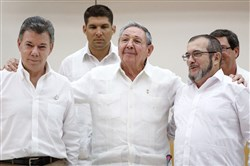 Cuba President Raul Castro stands with Colombian President Juan Manuel Santos, left, and FARC leader Timoleon Jimenez, right, in September.