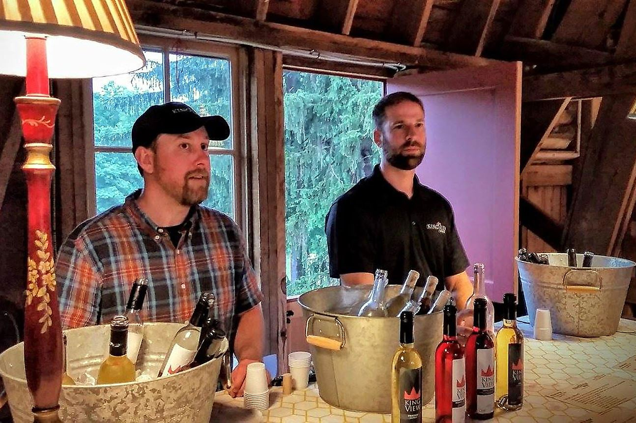 neeley_kiingview_mead-1 Scott Neeley, left, owner and head winemaker at KingView Mead, with his business partner Steve Shepard at a June 16 tasting event at Dundee Farm and Fields near Sewickley.
