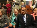This photo provided by Rep. Chillie Pingree,D-Maine, shows Democrat members of Congress, including Rep. John Lewis, D-Ga., center, and Rep. Elizabeth Esty, D-Conn. as they participate in a sit-down protest seeking a vote on gun control measures Wednesday.