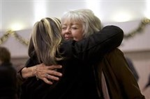 A member of the congregation at New Covenant Community Church embraces Terri Roberts, the mother of Amish school shooter Charles Roberts, after she spoke during a service in Delta, Pa.
