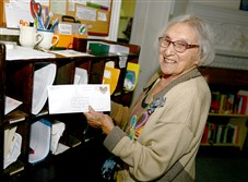 Marion Damick gets a letter from an inmate she has been helping at The Religious Society of Friends of Pittsburgh in Shadyside.
