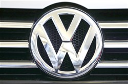 The Volkswagen logo is seen on the grill of a Volkswagen on display in Pittsburgh.