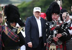 The presumptive Republican presidential nominee  Donald Trump  poses with a bagpiper as he arrives at his revamped Trump Turnberry golf course in Turnberry Scotland Friday.