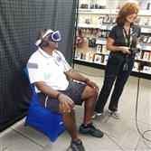 Taken at the Century III Best Buy, Friday June 24, 2016. Bill Fitch tries out PlayStation VR for the first time.