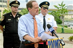 U.S. Sen. Pat Toomey, R-Pa., talks about police access to federal equipment during a campaign stop Monday at the Law Enforcement Officers Memorial on the North Shore.