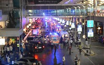 Ambulances and police set up a perimeter after two explosions followed by gunfire were reported Tuesday at Istanbul's Ataturk airport. At least 10 people were killed in the suicide attack.