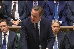 In this image taken from the Parliamentary Recording Unit Britain's Prime Minister David Cameron addresses the House of Commons in London on Monday.