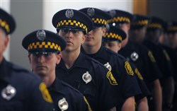 In this Aug. 30, 2016 file photo, the Pittsburgh Bureau of Police swears in 19 new recruits during a graduation ceremony at the University of Pittsburgh.