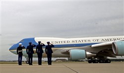 Military personnel salutes as Air Force One with President Barack Obama aboard departs June 23 at Andrews Air Force Base, Md.
