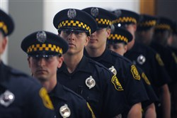 Pittsburgh Mayor Bill Peduto's proposed 2018 budget calls for three classes of police recruits such as the one seen here at a graduation ceremony in August 2016 that put 19 new officers on the streets.