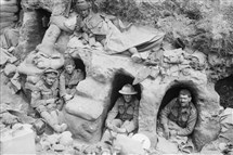 Men of the British Border Regiment rest in shallow dugouts near Thiepval Wood during the Battle of the Somme.