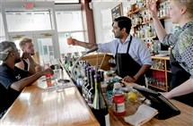 Bartender Javed Hashmi serves a drink to a customer at the Livermore in East Liberty. Experts cite employee makeup, rental agreement and target clientele as key determiners for a successful restaurant. And, of course: Location, location, location.