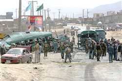 Afghan security forces inspect the site of a suicide attack Thursday on the outskirts of Kabul, Afghanistan.